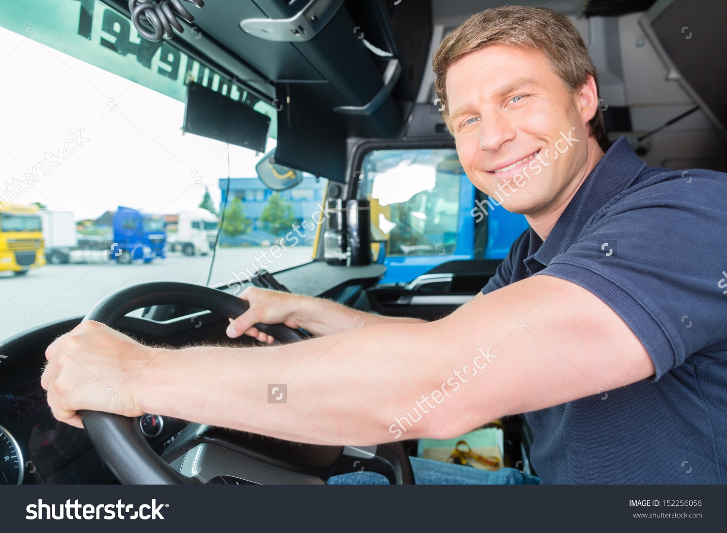 44d71e05 stock-photo-logistics-proud-driver-or-forwarder-in-drivers-cap-of-truck -and-trailer-on-a-transshipment-point-152256056